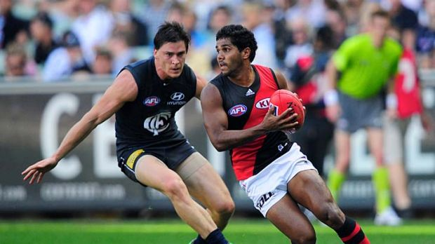Catch me if you can: Alwyn Davey leads Carlton's Nick Duigan a merry chase in the Bombers' upset win. Davey chipped in ...
