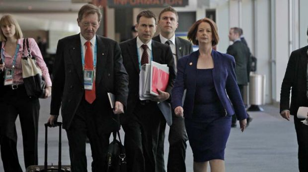 Salary hikes ... Prime Minister Julia Gillard with the head of her department Dr Ian Watt, left, will receive ...