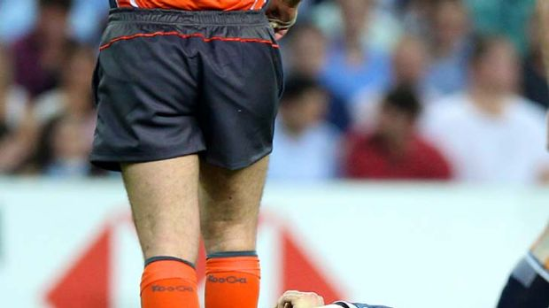 Hurt ... James O'Connor after colliding with Berrick Barnes.