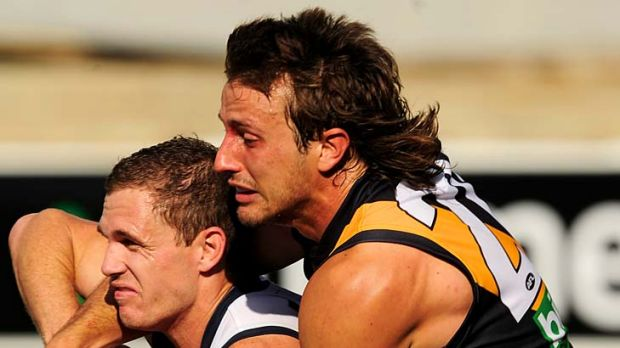 Squeeze: Richmond's Ivan Maric tackles Geelong's Joel Selwood.
