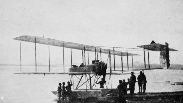 A Royal Navy, Henri Farman, tandem seated float plane, possibly from HMS Ark Royal, returning to its launching ramp. ...