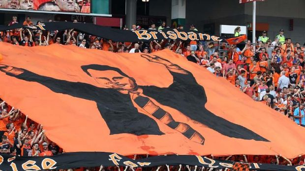 Roar fans show their support for coach Ange Postecoglou at the A-League Grand Final match.  (Photo by Bradley Kanaris/)