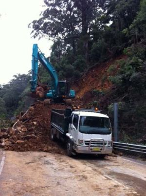 Council workers have been trying to clear debris blocking the highway since Friday.