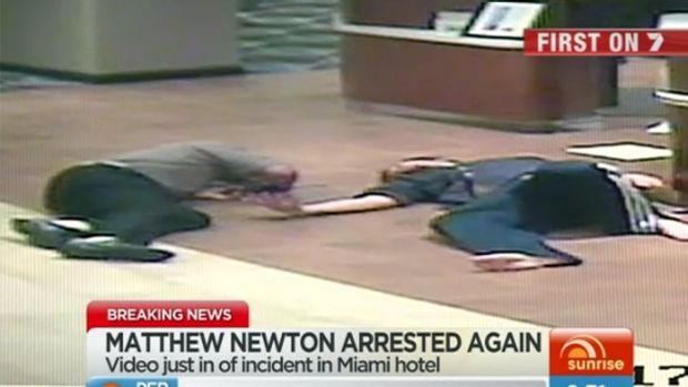 Hotel CCTV....Matthew Newton, right, is seen rolling on the floor alongside the hotel clerk, who appears injured in ...