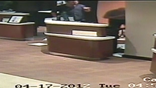 Pointing the finger ... Video footage shows a punch being thrown before the hotel worker, right,  walks away from Newton ...