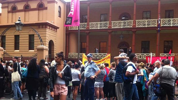 Making themselves heard ... the protesters have gathered in front of Parliament House.