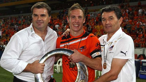 (L-R) Ange Postecoglou, Matthew Smith and Dario Vidosic of the Roar hold the winners trophy after the 2012 A-League ...