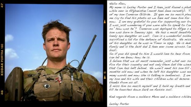 Corporal Cameron Gilbride from Mentoring Taskforce 4 based at Patrol Base Wali in the Mirabad Valley, Afghanistan, and a ...