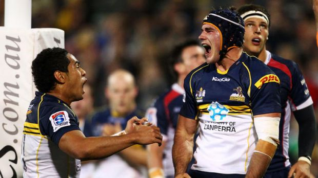 Ben Mowen of the Brumbies celebrates scoring a try during the round eight Super Rugby match between the Brumbies and the ...