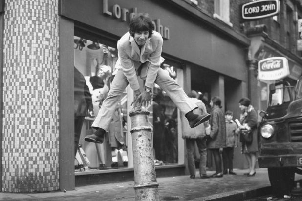 Singer Cat Stevens leaps a bollard in Carnaby Street, London, in 1967.  Photo by Getty Images