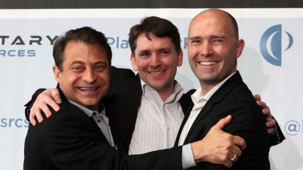 Planetary Resources co-founders and co-chairmen Peter H. Diamandis, left, and Eric Anderson, right, embrace president ...