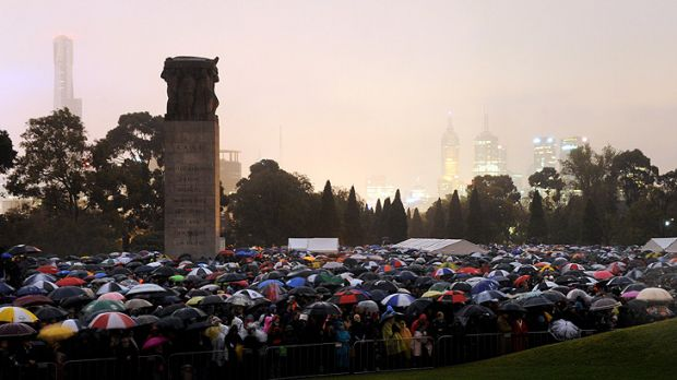 A sea of umbrellas as thousands pay their respects in the city.