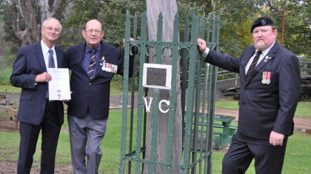 From left: Neville Harris, with Euroa RSL officers Phil Munt and Fred Wawrzik at VC winner Alex Burton's memorial.