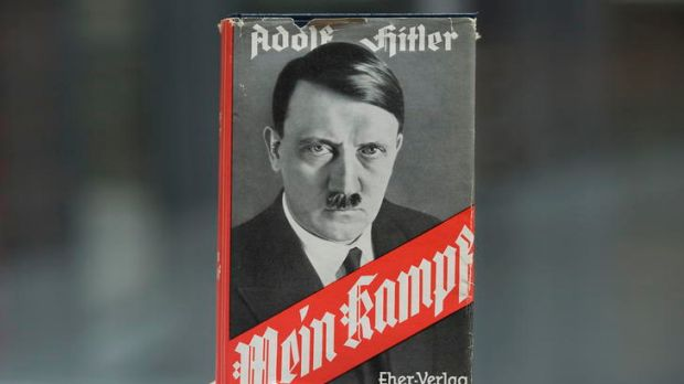 "Adolf Hitler's infamous memoir ""Mein Kampf"" is presented during a news conference in Nuremberg on Tuesday."
