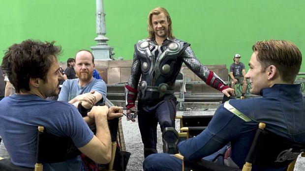 Time for heroics … Joss Whedon (second from left) and his stars on set.