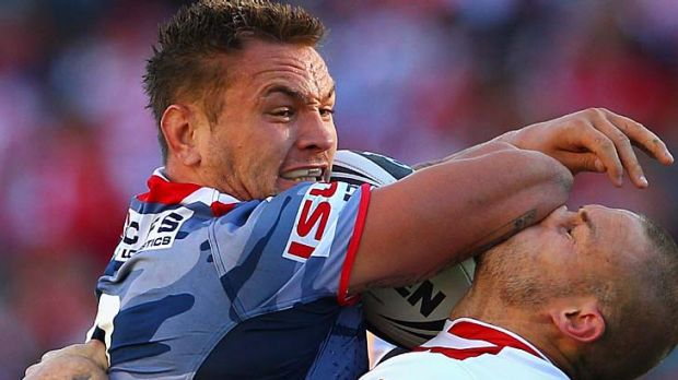 Tough contest ... Jared Waerea-Hargreaves of the Roosters fends off Matt Cooper of the Dragons.