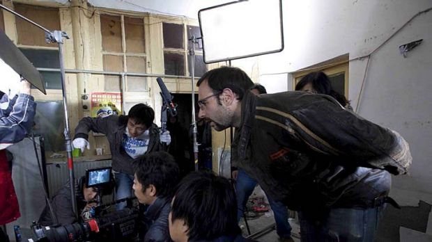 Voutas (right) directs a scene from <i>Red Light Revolution</i> on location in Beijing.