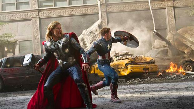 In this film image released by Disney, Chris Hemsworth portrays Thor, left, and  and Chris Evans portrays Captain ...