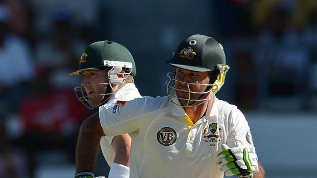 Australian batsmen Ricky Ponting (right) and Michael Clarke make a run.