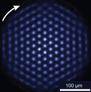 Super computer ... A device called a quantum simulator made from 300 charged beryllium atoms (blue dots) suspended in ...