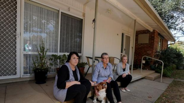 The late Joan Barrett's daughters  Sally Ayers, left, Jane Elliot and granddaughter Bec Ayers  and Joan's dog Cookie, a ...