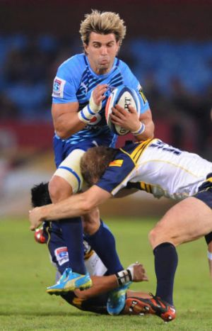 Wynand Olivier tackled by Christian Lealiifano and Pat McCabe during the Super Rugby Round 9 match between Vodacom Bulls ...