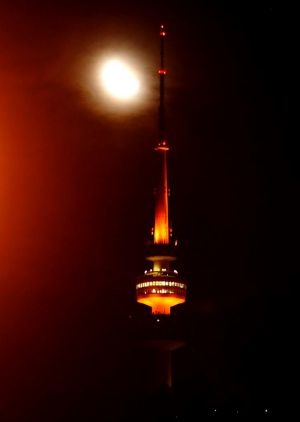 26TH APRIL 2012- SPORT- STORY LEE GASKIN - THE CANBERRA TIMES- PHOTO BY MELISSA ADAMS. Telstra Tower lit up orange for ...