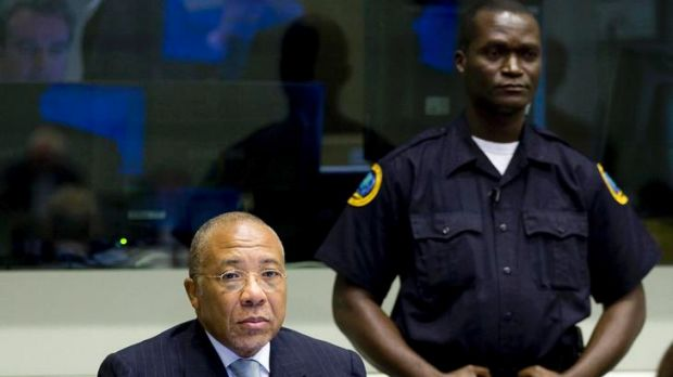 Former Liberian President Charles Taylor sits down at the UN-backed Special Court.