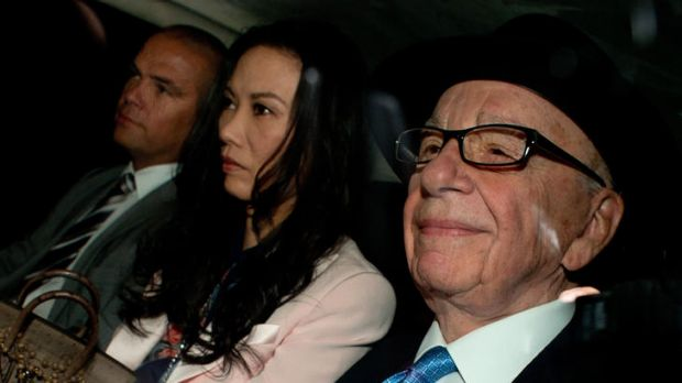 Second day of the inquiry ... News Corp chief Rupert Murdoch (right) his wife Wendi Deng (centre) and son Lachlan (left) ...