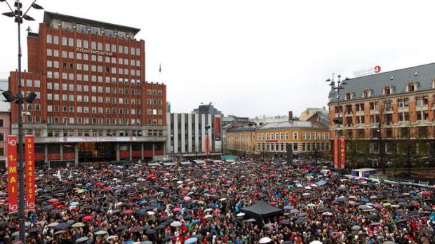 Thousands of people turn up in poor weather to participate in the singing of a popular children's song at the ...