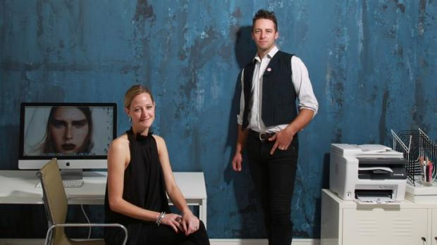 Rachael Hart and Matthew Collins and the wall Collins painted in Hart's office.