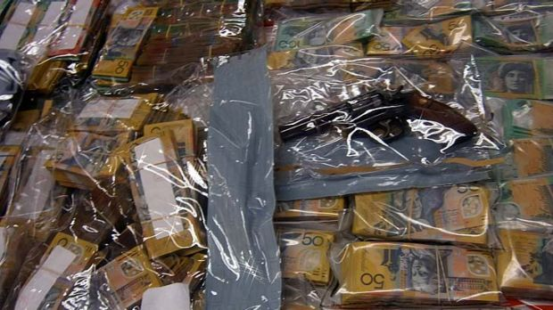 Cash and a gun that was among the record haul seized by police.
