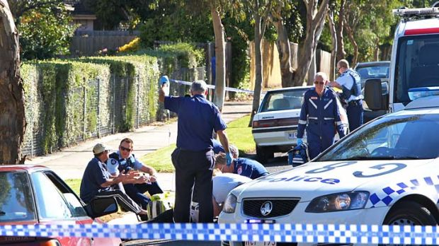 Paramedics and police at the scene of the fatal hit-run out the front of Karingal Bowls Club.