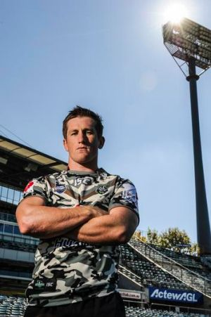 Canberra Raiders' Josh McCrone shows off the special Anzac camouflage shirts ahead of their game on Sunday.