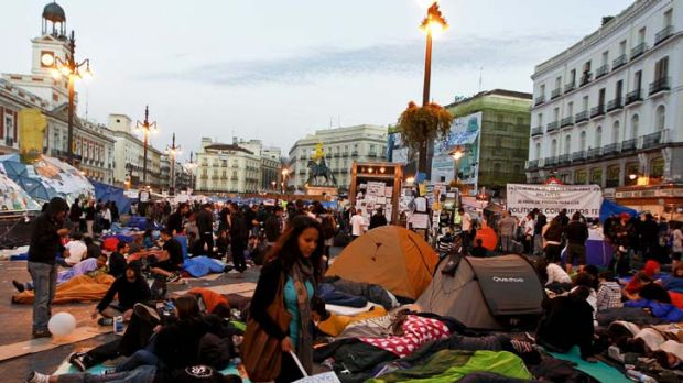 Spaniards take to the streets in protest over sky-high unemployment in Madrid. The jobless rate in Spain hit 24.4 per ...