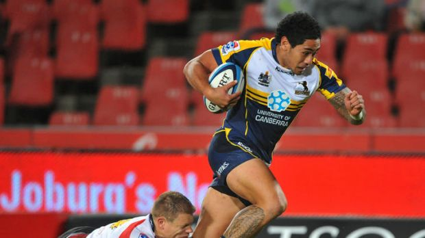 Joe Tomane of the Brumbies drives over for a try.