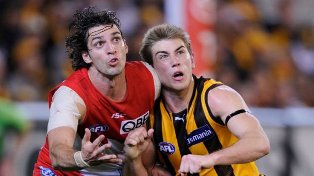 Sydney's Matt Spangher and Hawthorn's Ryan Schoenmakers battle it out in last year's finals. This season the teams have ...