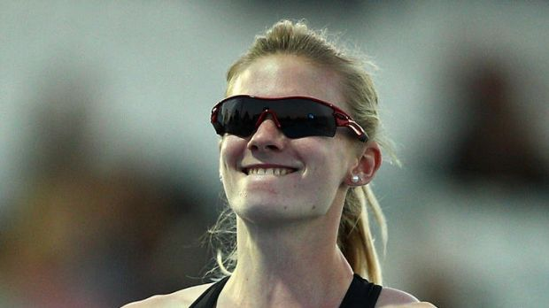 Canberra's Melissa Breen again fell short of the Olympic A-qualifying time in Japan after the race clock initially ...