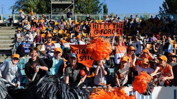 Giants supporters show their colours at Manuka Oval.