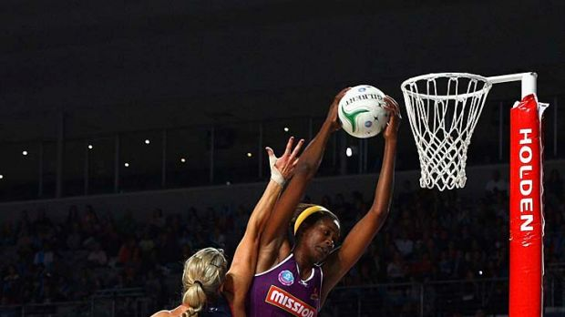 Tall order: Firebird Romelda Aiken gets the ball over Vixen Julie Corletto yesterday.