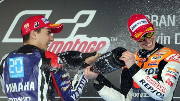 Casey Stoner and  Jorge Lorenzo celebrate on the podium after the Spanish Grand Prix.