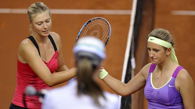 Belarus' Victoria Azarenka (R) congratulates Russia's Maria Sharapova (L) after the final of the WTA Porsche Tennis ...