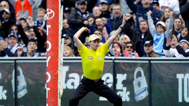 Goal umpire: two of them are needed now, say critics of video review system.