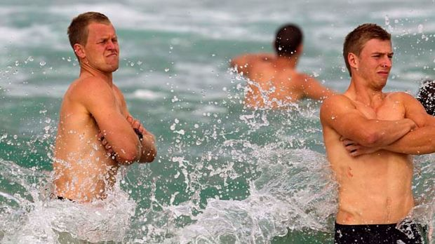 Making a splash: Swans Ryan O'Keefe and Kieren Jack at a Bondi Beach recovery session yesterday.