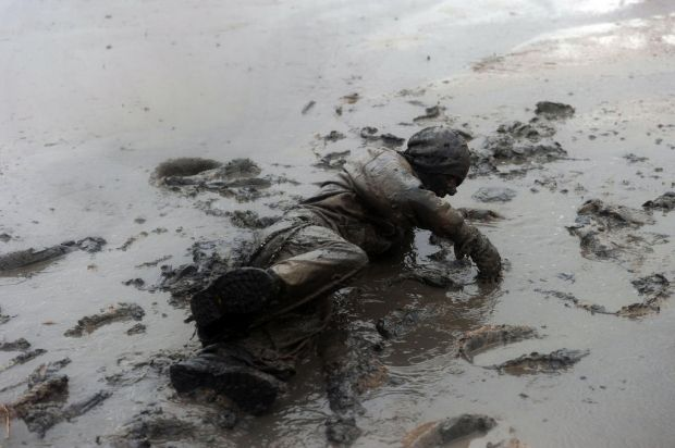 A competitor falls in the mud as he takes part in the Maldon Mud Race in Maldon, Essex