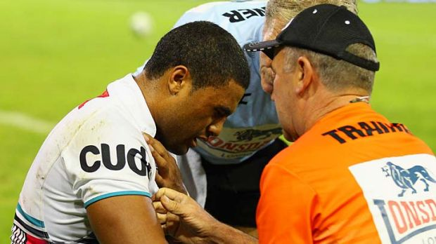 Michael Jennings of the Panthers receives attention for an injury during the match against the Knights.