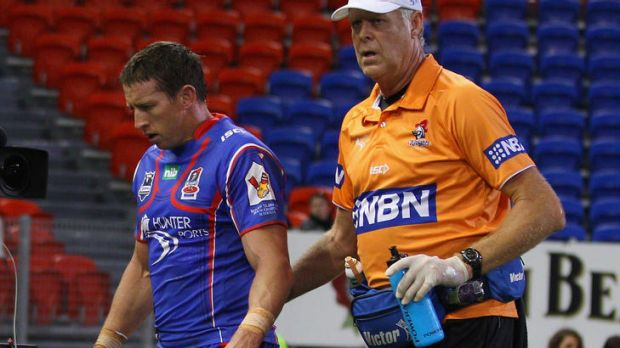 NEWCASTLE, AUSTRALIA - APRIL 30:  Kurt Gidley of the Knights leaves the field with an injury during the round eight NRL ...