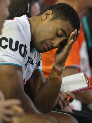 NEWCASTLE, AUSTRALIA - APRIL 30:  Michael Jennings of the Panthers looks dejected as he sits on the bench after injuring ...