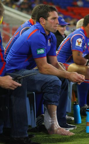 NEWCASTLE, AUSTRALIA - APRIL 30:  Danny Buderus of the Knights watches on from the bench with ice on his leg during the ...