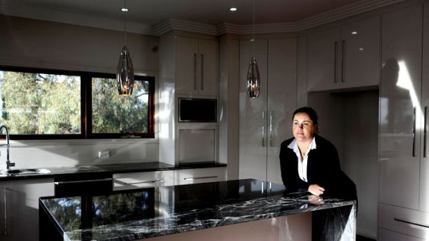 Exclusivity ... Luton senior property manager Tamara Davis in a Red Hill property which would set someone back $2500 a ...